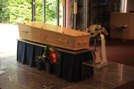 crematorium: Plain light wooden coffin in a crematorium