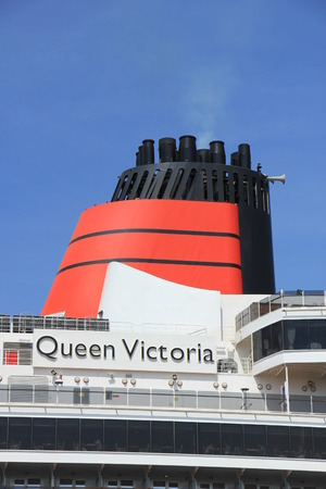 ijmuiden: IJmuiden, The Netherlands - June 5th 2017: Queen Victoria, Cunard on North Sea Channel, detail of funnel Editorial