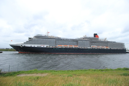 queen victoria: Velsen, The Netherlands - June 7th 2017: Queen Victoria, Cunard on North Sea Channel in heavy weather towards IJmuiden sea lock and North Sea