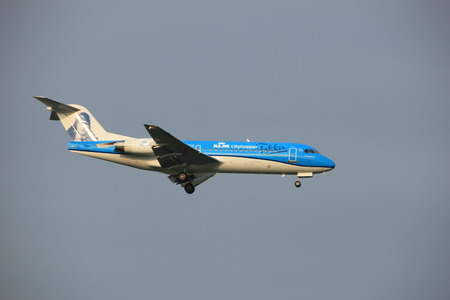 polderbaan: Amsterdam, the Netherlands - June 22nd 2017: PH-KZU KLM Cityhopper Fokker F70 approaching Polderbaan runway at Schiphol Amsterdam Airport, the Netherlands, painted in Anthony Fokker (Farewell) special colours