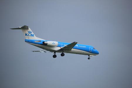Amsterdam, the Netherlands - June 22nd 2017: PH-KZP KLM Cityhopper Fokker F70 approaching Polderbaan runway at Schiphol Amsterdam Airport, the Netherlands Editorial