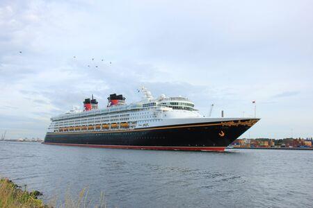 cruising: Velsen, the Netherlands - June, 27th 2017: Disney Magic on North Sea Canal, sailing towards Amsterdam Cruise terminal