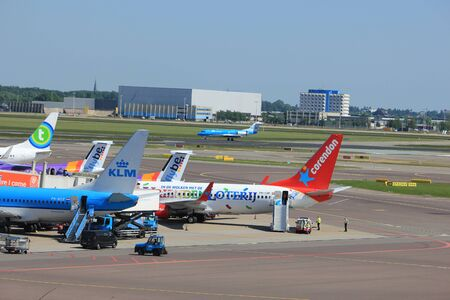 Amsterdam The Netherlands -  May 26th 2017: various airlines parked at gate at Schiphol International Airport Editorial