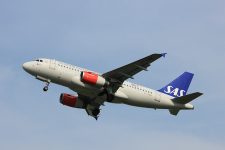 Amsterdam, the Netherlands  -  June 2nd, 2017: OY-KBR SAS Scandinavian Airlines Airbus A319 taking off from Polderbaan Runway Amsterdam Airport Schiphol