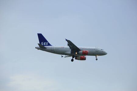 Amsterdam the Netherlands - July 6th 2017: OY-KBT SAS Scandinavian Airlines Airbus A319 approaching Schiphol Amsterdam Airport Polderbaan runway