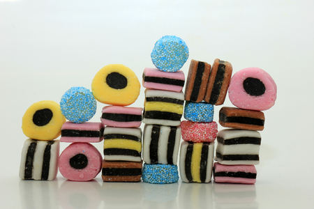 Stacked liquorice all sorts in different shapes, colors and sizes Stok Fotoğraf
