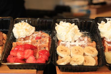made in belgium: Fresh made Belgium waffles with banana or strawberries and cream