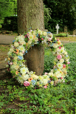 Sympathy wreath in pastel colors, made of various flowers