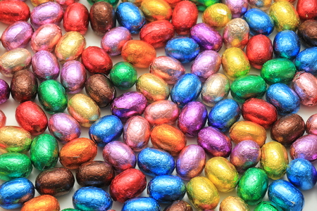 Big pile of colorful wrapped chocolate easter eggs