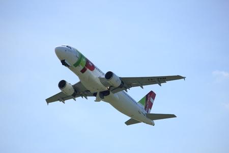 cs: Amsterdam the Netherlands - July, 9th 2017: CS-TNM TAP - Air Portugal Airbus A320-214 takeoff from Buitenveldert runway Amsterdam Airport