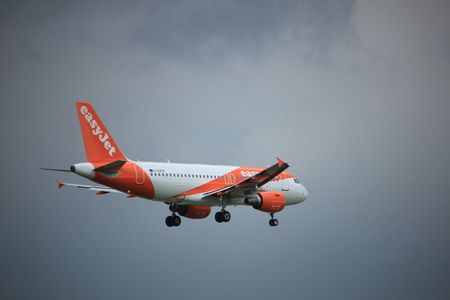 Amsterdam the Netherlands - July 20th 2017: G-EZFR easyJet Airbus A319 approaching Schiphol Amsterdam Airport Polderbaan runway Editorial