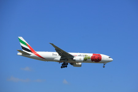 Amsterdam the Netherlands - July 9th 2017: A6-EFL Emirates Boeing 777 approaching Schiphol Amsterdam Airport Kaagbaan runway, Red Rose livery