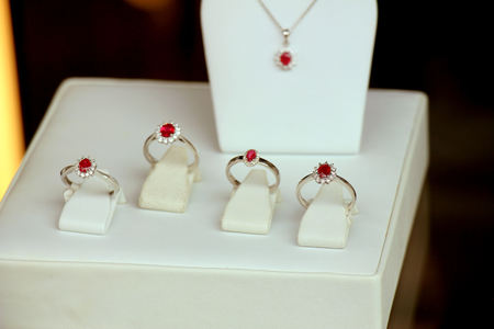 platinum: Classic Diamond engagement rings in a shop window, red ruby with diamond halo