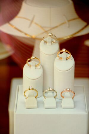 diamond ring: Solitaire Diamond engagement rings in a shop window Stock Photo