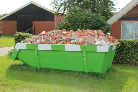 Loaded dumpster near a construction site, home renovation Stock fotó - 84113798