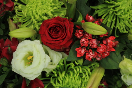 mixed marriage: Classic green,  red and white bouquet for a wedding