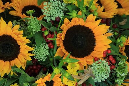 helianthus: Big yellow sunflowers in a wedding flower arrangement