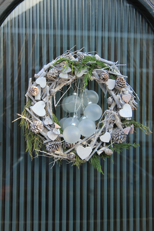 windows and doors: christmas wreath with decorations on a door