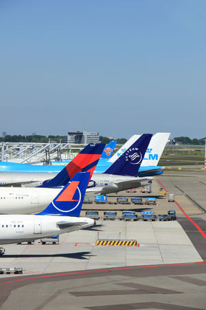 Amsterdam The Netherlands -  May 26th 2017: Planes of several major airlines parked at the gates at Schiphol Amsterdam International Airport