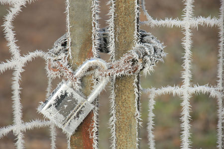 Hoarfrost on a padlock and chain