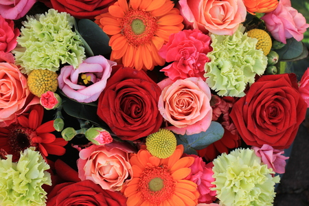 mixed marriage: Mixed flower arrangement: various flowers in different shades of red, pink and orange Stock Photo