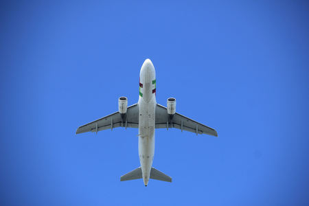 A midsize Airplane, a few seconds after takeoff Stock Photo