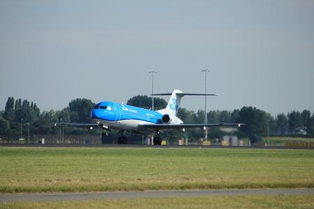 Amsterdam, the Netherlands  - August, 18th 2016: PH-KZU  KLM Cityhopper Fokker F70,  taking off from Polderbaan Runway Amsterdam Airport Schiphol Editorial