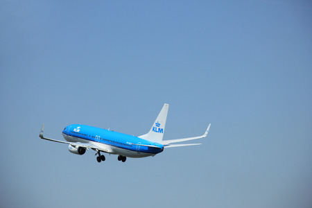 Amsterdam, The Netherlands - June 12 2015:  PH-BCE KLM Royal Dutch Airlines Boeing 737-800  takes of from Amsterdam Airport Polderbaan runway. Editorial