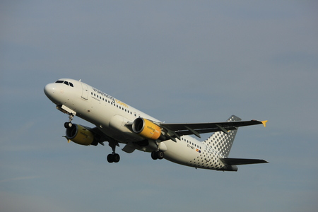 Amsterdam, the Netherlands  -  June 2nd, 2017: EC-MBY Vueling Airbus A320 taking off from Polderbaan Runway Amsterdam Airport Schiphol Editorial