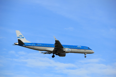 Amsterdam, the Netherlands - July 15th 2016:PH-EXA KLM Cityhopper Embraer ERJ-190STD approaching Polderbaan runway at Schiphol Amsterdam Airport, arriving from Leeds, United Kingdom