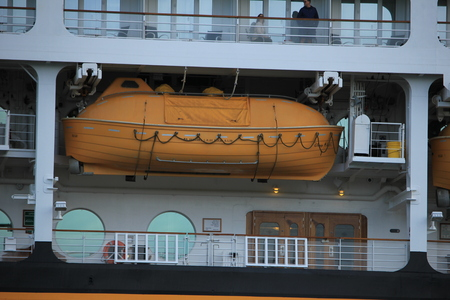 Velsen, the Netherlands - June, 27th 2017: Disney Magic on North Sea Canal, detail of cabins and lifeboats Editorial