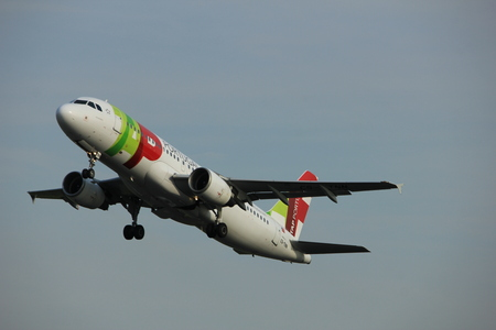Amsterdam, the Netherlands  -  June 2nd, 2017: CS-TNN TAP - Air Portugal Airbus A320 taking off from Polderbaan Runway Amsterdam Airport Schiphol