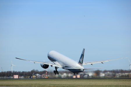 Amsterdam the Netherlands - March 25th, 2017: B-KQY Cathay Pacific Boeing 777-300 takeoff from Polderbaan runway.