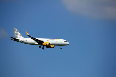 Amsterdam the Netherlands - August 27th 2017: EC-MEL Vueling Airbus A320-200 approaching Schiphol Amsterdam Airport Kaagbaan runway