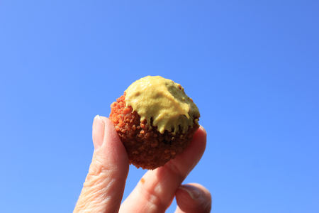 Dutch Bitterbal warm stuffed fried meatbal, served in the Netherlands with mustard