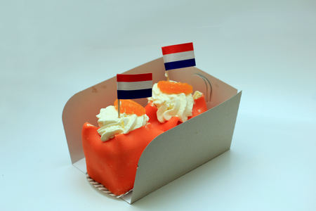 Orange Marzipan confectionery with Dutch flag to celebrate King's Day on April 27th. Orange is the national color in the Netherlands