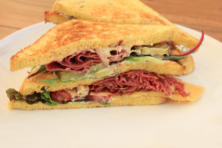 A fresh pastrami sandwich: charcuterie, lettuce, pickles and mayonaisse