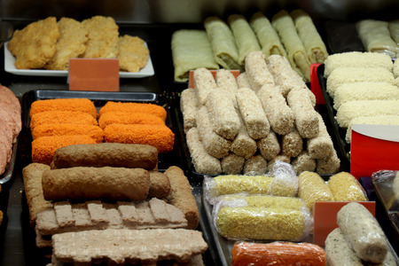 Various sorts of raw snacks on display in a fast food restaurant
