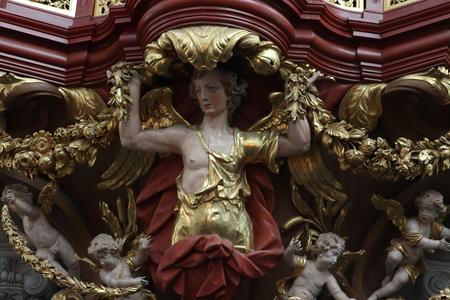 Haarlem, the Netherlands - october 6th, 2018: detail of the pipe organ at Sint-Bavokerk in Haarlem, the Netherlands. Редакционное