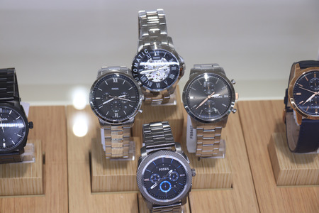 Haarlem, The Netherlands - October 6th 2018: Fossil watches in a shop window. Fossil Group, Inc. is an American fashion designer and manufacturer founded in 1984