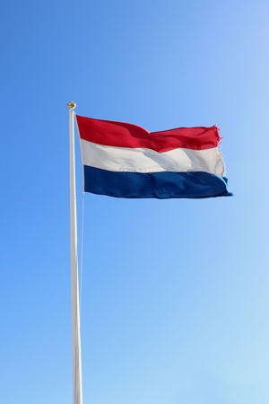 Frayed flag of the Netherlands in red, white and blue