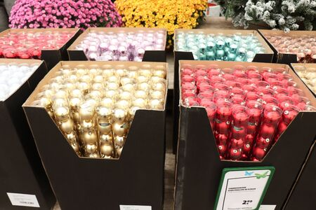 Cruquius, the Netherlands - October 26th 2018: Plastic baubles in an interior decoration shop. Dutch text on tag: unbreakable baubles in cover Editorial