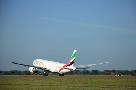 Amsterdam, the Netherlands - June 9th 2016: A6-EFJ Emirates Boeing 777-F1H, departing from Polderbaan runway Schiphol, destination Culumbus, Ohio (USA)