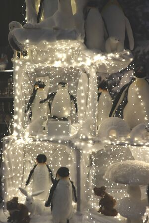 Cruquius, the Netherlands - October 26th 2018: Christmas illumination penguins an interior decoration shop Editorial