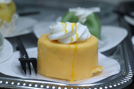 Fresh Marzipan confectionery with cream and liquor decoration