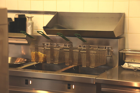 Fast food restaurant kitchen, frying equipment and raw french fries
