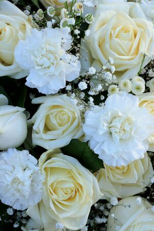 A floral wedding arrangement: white roses, carnations and white Gypsophila or Baby's Breath