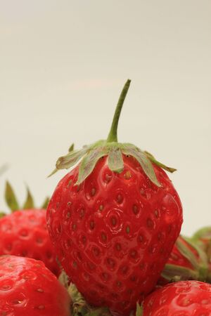 Big single strawberry in extreme close up