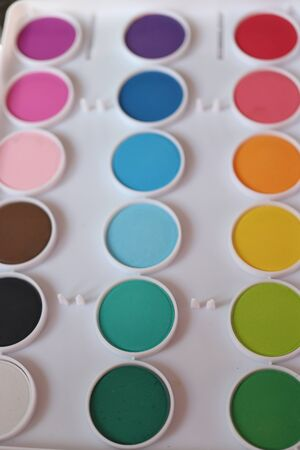 Different colors of waterpaint in a white color box 版權商用圖片