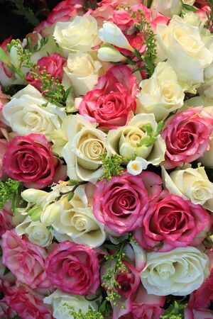 Floral wedding decorations: Mixed pink and white roses